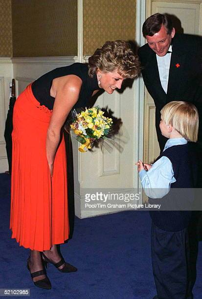 Princess Diana Patron Of British Red Cross Youth At The Red Cross Concert To Commemorate Ve Day Receives A Bouquet Of Flowers From Ben Clark Aged 5