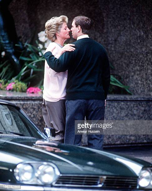 Princess Diana Princess of Wales and Prince Andrew Duke of York greet each other with a kiss as the meet outside the Portland Hospital following the...