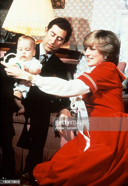 Princess Diana Princess of Wales and Prince Charles Prince of Wales pose with their baby son Prince William during the Christmas season at Kensington...