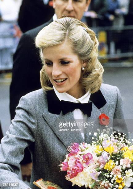 Princess Diana Princess of Wales in a new hairstyle and wearing an outfit described as 'A Teddy Boy Look' vists Dr Barnado's Charity in London in...