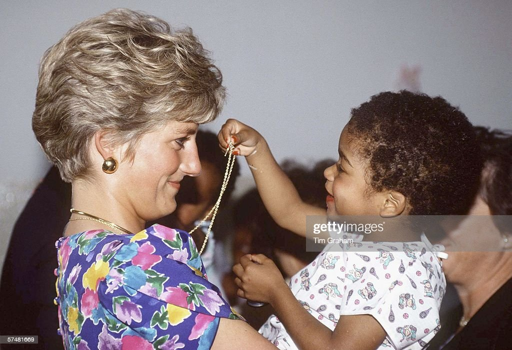 Princess Diana Cuddles Child in Brazil : News Photo
