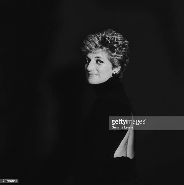 Princess Diana Princess of Wales posing against a dark background circa 1995
