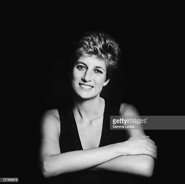 Princess Diana Princess of Wales posing against a dark background circa 1995