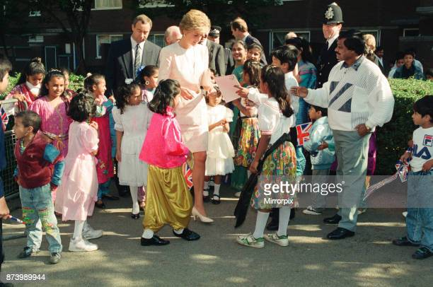 Princess Diana Princess of Wales tours the Guinness Estate in Mansell Street Aldgate East London Bobby Begum Jenny and Polly Begum held hands The...