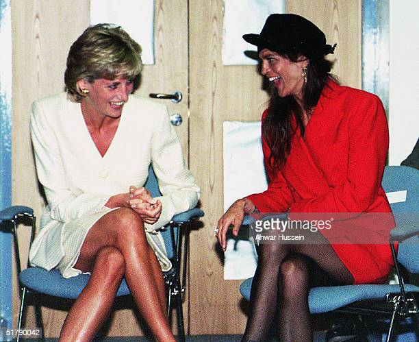 Princess Diana shares a laugh with Aileen Getty grand daughter of J Paul Getty during a visit to an AIDS Centre on June 27 1996 in London England