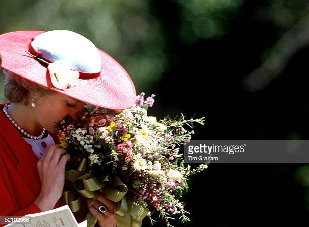 Princess Diana Smelling The Flowers In A Bouquet She Has Been Given During A Visit To The Royal Botanical Gardens In Melbourne Australia
