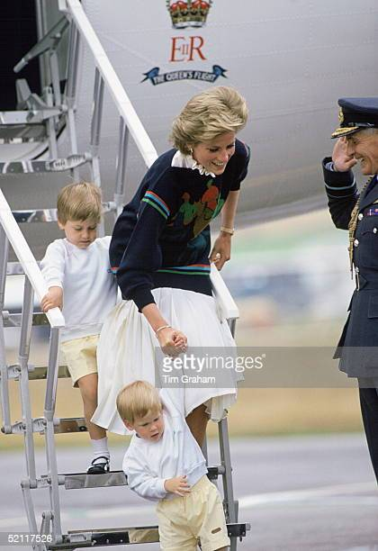 Princess Diana Stepping Off A Royal Flight With Her Sons Prince William And Prince Harry At Aberdeen Airport At The Start Of Their Holiday Her Jumper...