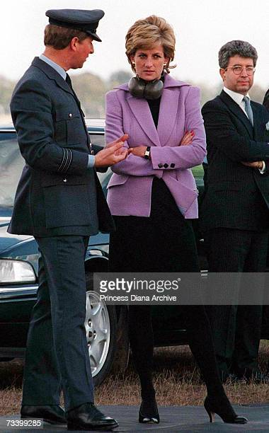 Princess Diana talking to an officer after watching an air display at RAF Wittering Lincolnshire September 1995 On the right is Princess' private...