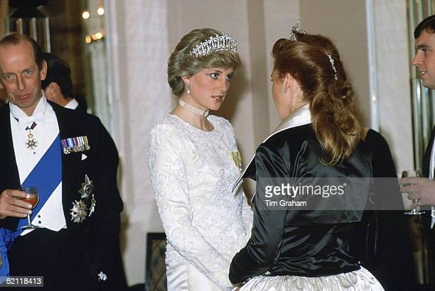 Princess Diana Talking To The Duchess Of York At A Banquet At Claridges Hotel In London. Diana Is Wearing A Pearl And Diamond Tiara That Was A Gift...