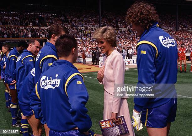 Princess Diana talking to Wimbledon's Dennis Wise watched by Dave Beasant prior to the FA Cup Final against Liverpool at Wembley Stadium in London...