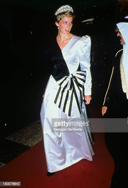 Princess Diana the Princess of Wales wearing an evening dress designed by the Emmanuels arrives at a dinner given by the Crown Prince in Saudi Arabia...