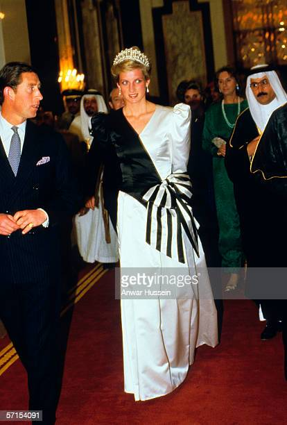 Princess Diana the Princess of Wales wearing an evening dress designed by the Emmanuels and accompanied by Prince Charles the Prince of Wales arrives...