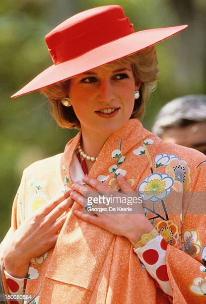 Princess Diana trying on a kimono that she received as a gift at Nijo Castle, Kyoto, during an official visit to Japan on May 1986.