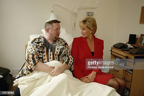 Princess Diana visiting a patient at the London Lighthouse a centre for people affected by HIV and AIDS in London October 1996