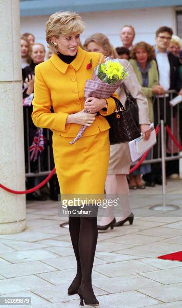 Princess Diana Visiting Liverpool Diana Is Wearing A Bright Orange Suit Designed By Fashion Designer Versace And She Is Carrying A Handbag Designed...