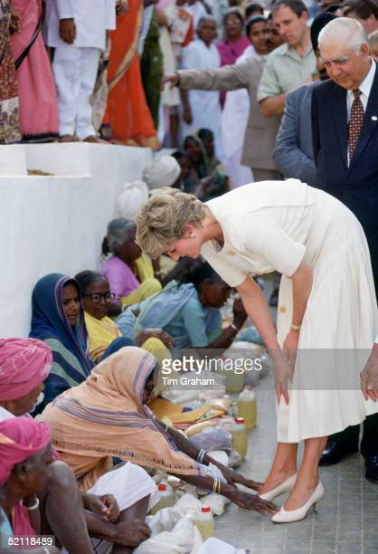 Princess Diana Visiting Mianpur Old Age Welfare Centre In Hyderabad, India Has Her Feet Touched By A Woman As A Sign Of Respect.