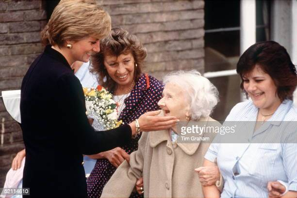 Princess Diana Visiting The Lord Gage Centre For Old People A Guinness Trust Home In Newham East London Princess Diana Is Touching The Face Of An...