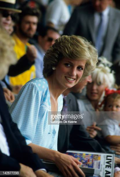 Princess Diana watches from the crowd during the Live Aid concert at Wembley Stadium in London 13th July 1985 The concert raised funds for famine...