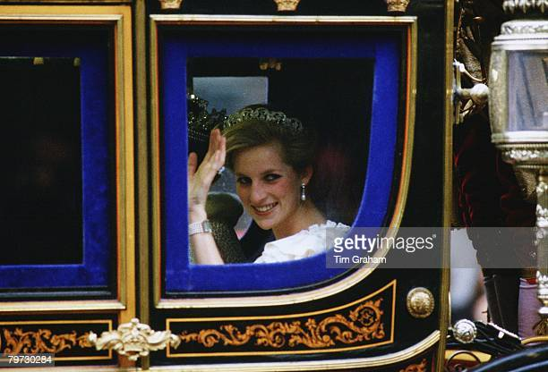 Princess Diana waves from a state coach on the way to the State Opening of Parliament