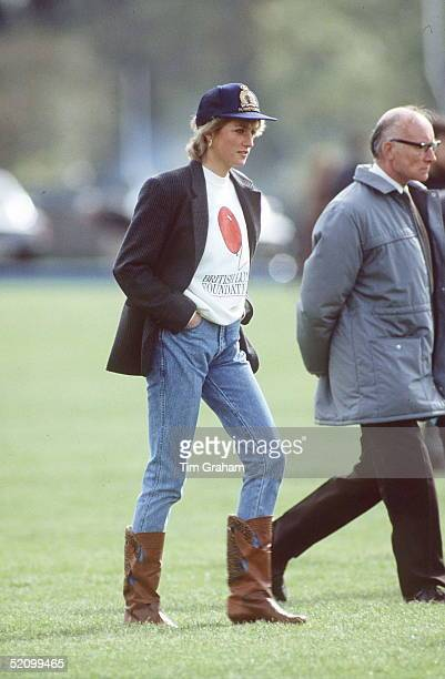 Princess Diana Wearing A British Lung Foundation Sweatshirt A Baseball Cap Boots And Jeans To Guards Polo Club In Windsor