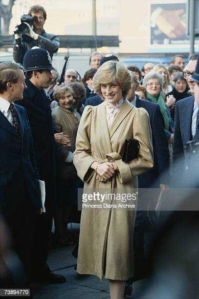Princess Diana wearing a Caroline Charles coat during a visit to Wandsworth DHSS office, December 1982.