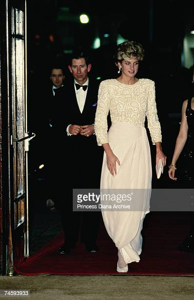 Princess Diana , wearing a Catherine Walker evening dress, arriving with Prince Charles at the Dominion Theatre, London for the Royal Variety...