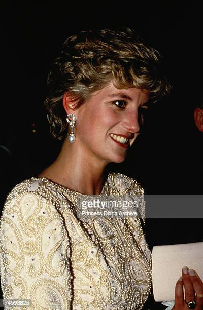Princess Diana , wearing a Catherine Walker evening dress, at the Royal Variety Performance at the Dominion Theatre, London, 7th December 1992.