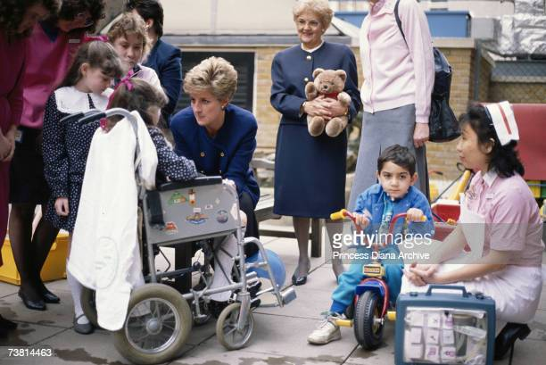 Princess Diana wearing a Chanel suit talking to patients at the Great Ormond Street Children's hospital in London March 1991