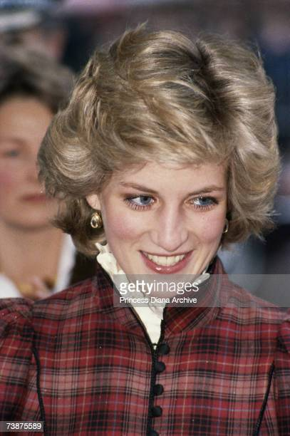 Princess Diana wearing a checked Caroline Charles dress during a visit to Bridgend in South Wales January 1985