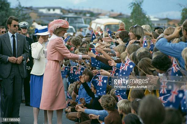 Princess Diana wearing a dress by fashion designer Bellville Sassoon is greeted by the crowd at the Woden School in Canberra Australia 25th March 1983