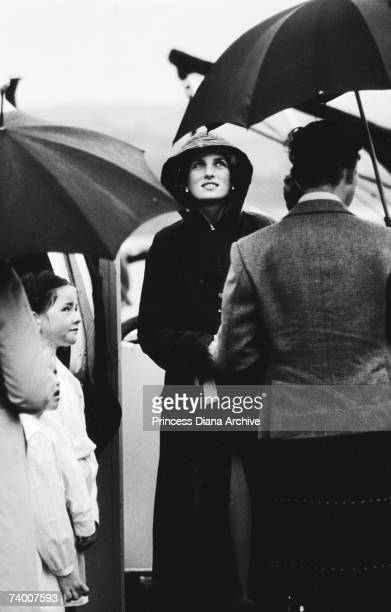 Princess Diana wearing a green barbour coat against the rain at Ardveenish on the island of Barra during a tour of the Western Isles July 1985