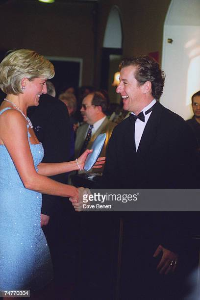 Princess Diana wearing a Jacques Azagury dress shakes hands with artistic director of the English National Ballet Derek Deane after a performance of...