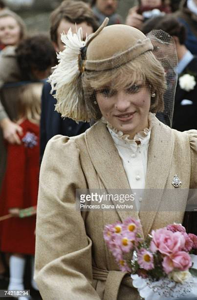 Princess Diana wearing a John Boyd hat and a tweed coat by Caroline Charles during a visit to St Davids Pembrokeshire November 1981