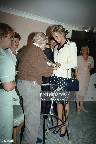 Princess Diana wearing a navy polka dot dress and white jacket during a visit to the Burges House nursing home in Cardiff 30th June 1993