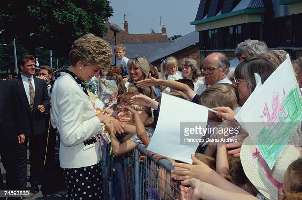 Princess Diana wearing a navy polka dot dress and white jacket during a visit to Tycoch Road Cardiff 30th June 1993