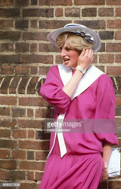 Princess Diana wearing a pink outfit at the wedding of her former flatmate Carolyn Pride and William Bartholomew in Chelsea, London, September 1982