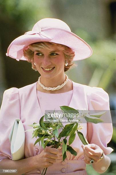 Princess Diana wearing a pink outfit by Catherine Walker and a John Boyd hat during a visit to a fruit farm in Sicily April 1985
