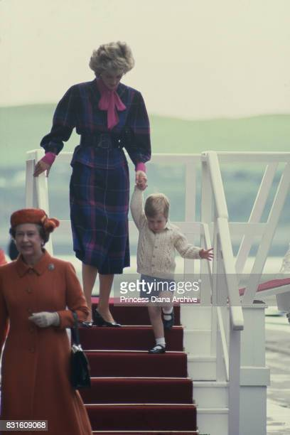 Princess Diana wearing a purple and pink tartan suit and Prince William leave the Royal Yacht Britannia right after Queen Elizabeth II Aberdeen...