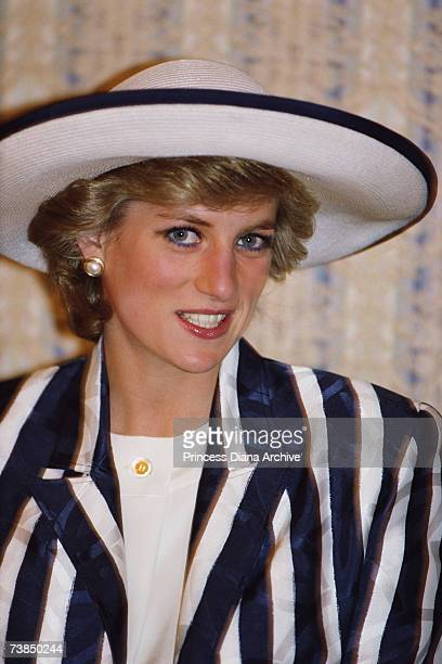 Princess Diana wearing a Roland Klein suit and a hat by Philip Somerville on her arrival in Kuwait for a state visit March 1989