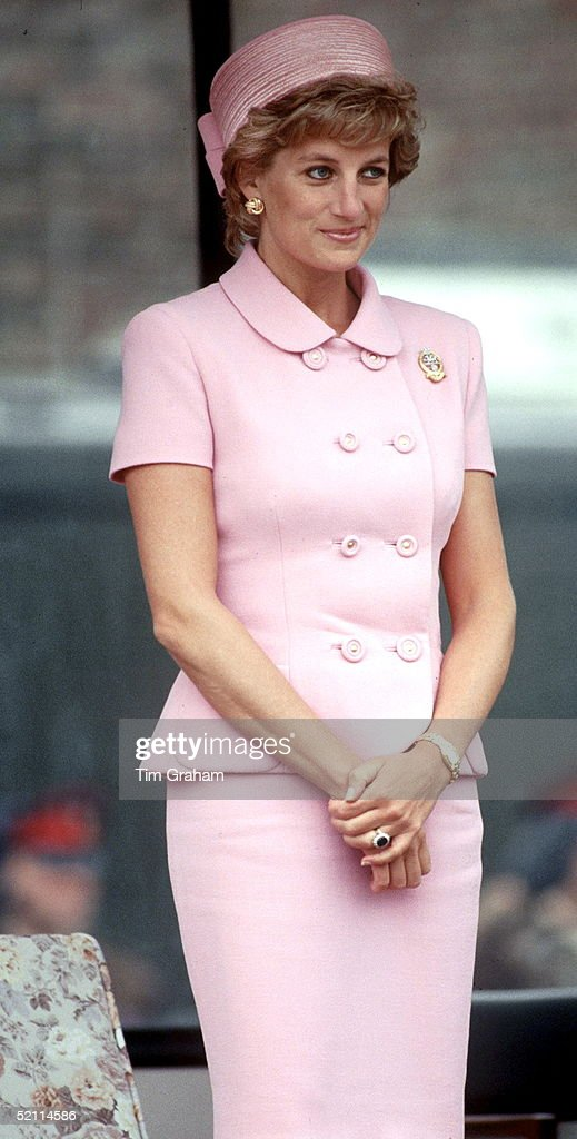 Princess Diana Wearing A Suit By Fashion Designers Versace For A Visit To A Regiment