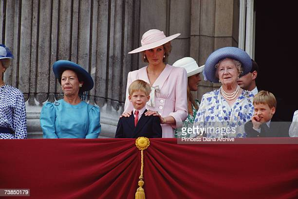 Princess Diana wearing a Victor Edelstein dress as she watches the Trooping of the Colour from a balcony at Buckingham Palace London June 1989 Left...