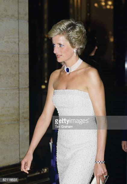 Princess Diana Wearing A White Strapless Dress Embroidered With Pearls Designed By Catherine Walker For A Banquet During Her Official Visit To...