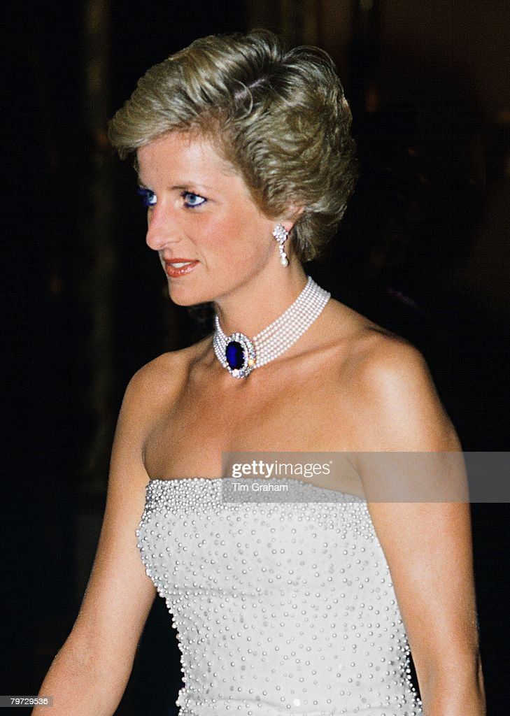 Princess Diana wearing a white strapless dress, embroidered : News Photo