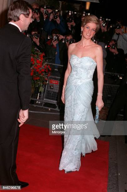 Princess Diana wearing an eggshell blue lace strapless evening dress designed by Catherine Walker attends a Moulin Rouge performance at The Savoy...