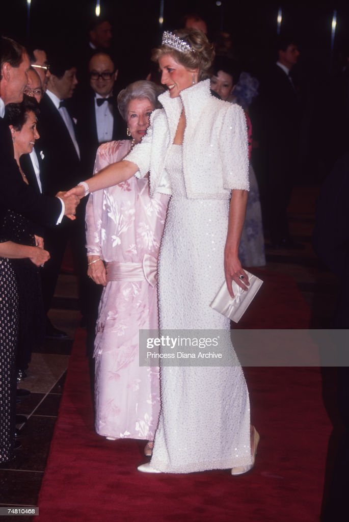 Princess Diana (1961 - 1997) wearing the Queen Mary tiara and her 'Elvis dress' by Catherine Walker, during a visit to the Culture Centre in Hong Kong, November 1989.