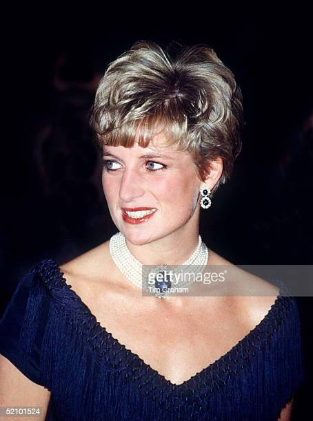 Princess Diana Wearing The Sapphire That The Q. Mother Gave To Her As A Wedding Present.