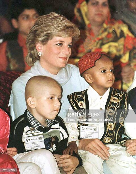 Princess Diana With A Young Pakistani Child On Her Lap During A Visit To Shaukat Khanum Hospital In Lahore, Pakistan.
