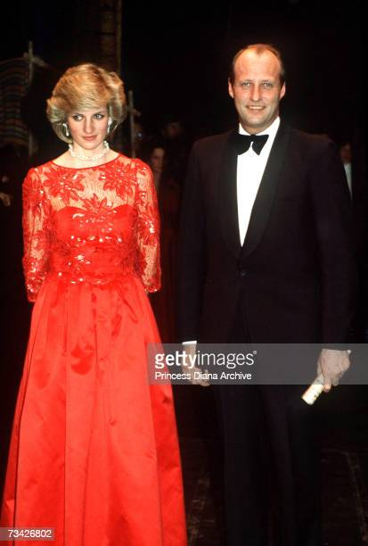 Princess Diana with Crown Prince Harald of Norway at a performance by the London City Ballet in Oslo Norway February 1984 She is wearing a red...