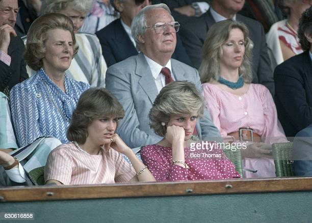 HRH Princess Diana with her former flatmate Carolyn Herbert in the Royal Box as they wait for play to commence on Centre Court after a rain storm at...