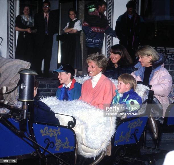 Princess Diana with her sons Prince William and Prince Harry and friends Kate Menzies and Catherine Soames in a horse-drawn sleigh during a skiing...